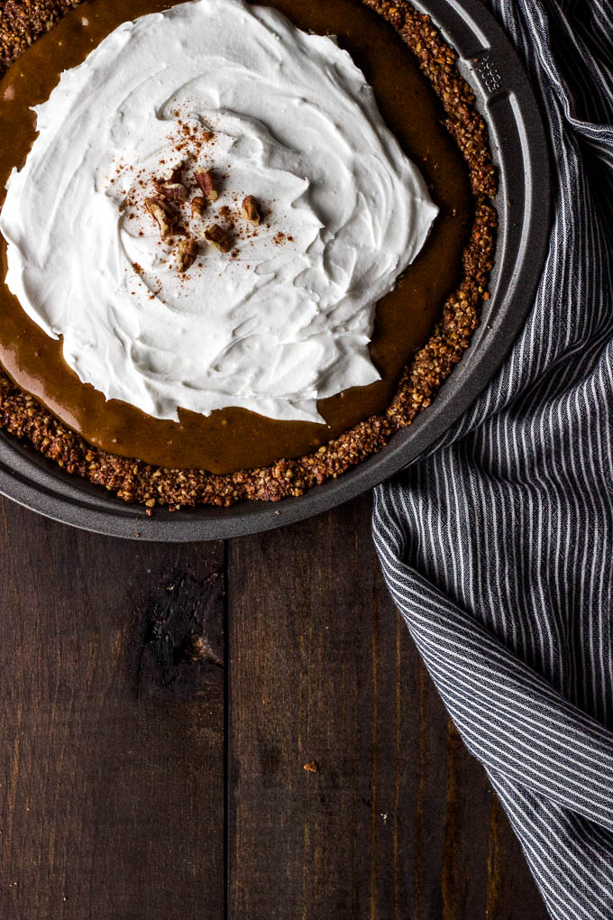 Pumpkin Cream Pie with Coconut-Pecan Crust is a simple holiday dessert! Gluten-free + Vegan | saltedplains.com