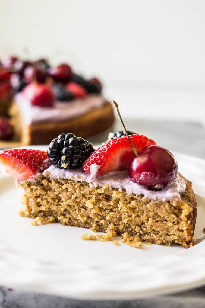 slice of cake with strawberries, blackberries, and cherries