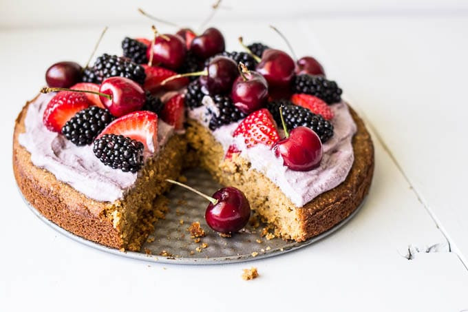 Coconut Cake with Blackberry-Coconut Whipped Cream and Mixed Berries #glutenfree | saltedplains.com