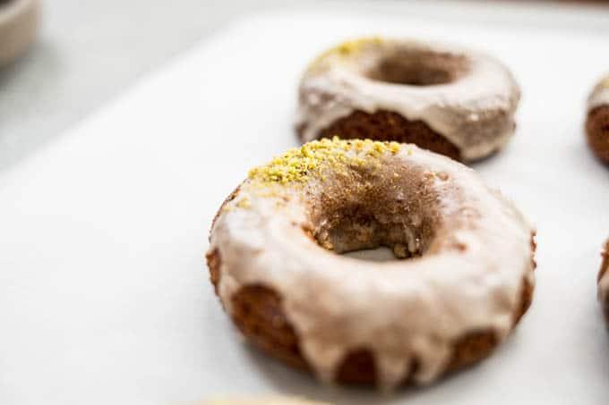 Irish Coffee Cake Donuts with glaze and pistachios.