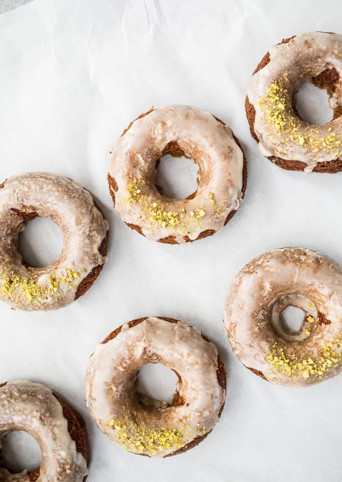 Irish Coffee Cake Donuts topped with a glaze and sprinkled with pistachios.