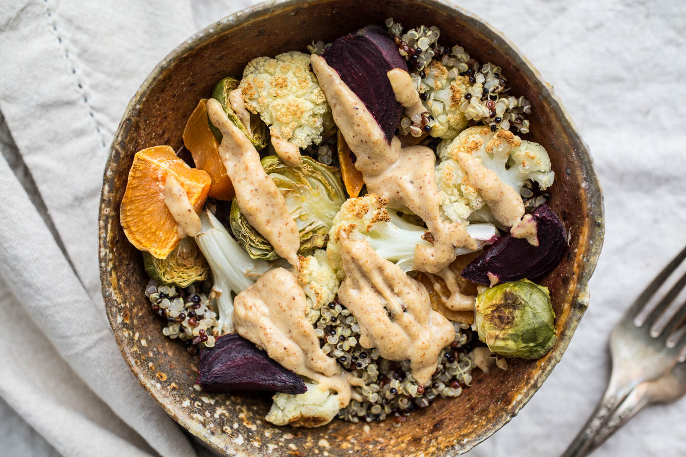 Roasted Vegetable and Quinoa Bowls with Coconut-Almond Sauce | saltedplains.com