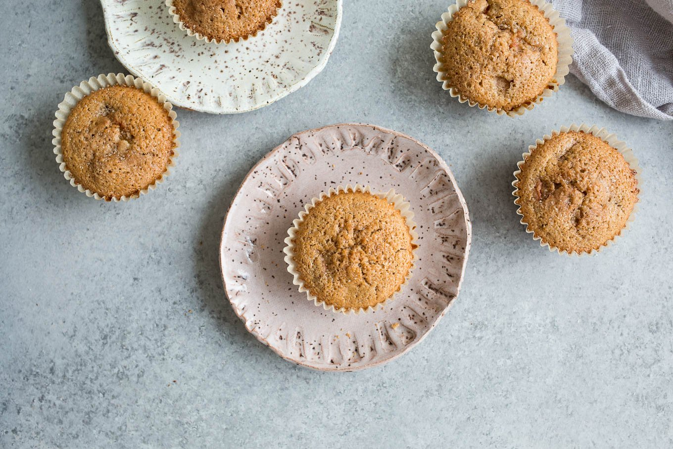 golden muffins in wrappers