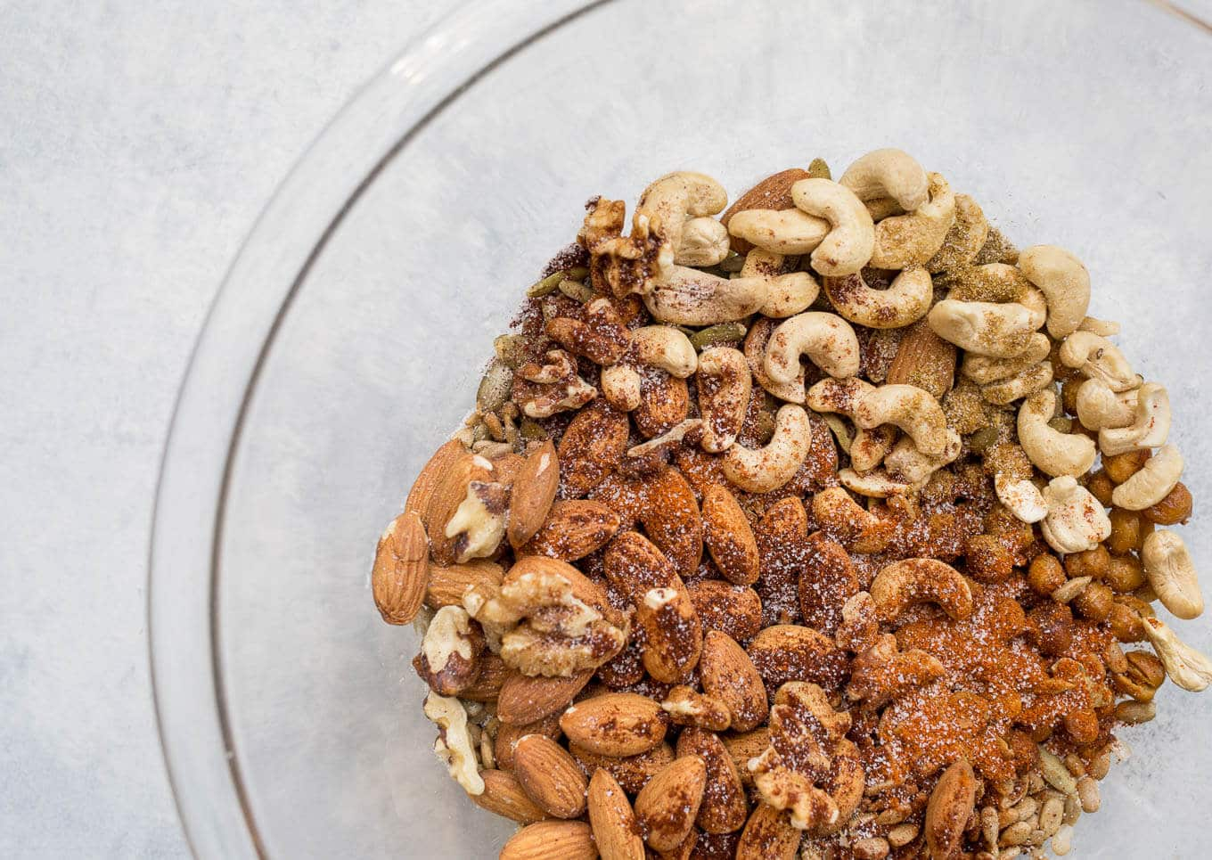 This Spicy Roasted Chickpea Snack Mix is loaded with roasted chickpeas, almonds, cashews, walnuts, pepitas, and sunflower seeds coated with a homemade spicy seasoning mix. Gluten-free, vegan.