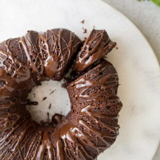This rich, moist Gluten-Free Chocolate Zucchini Cake is a one-bowl recipe that uses wholesome almond flour and unrefined coconut sugar. Gluten-free, dairy-free.