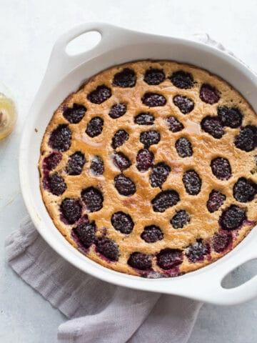 This Blackberry Honey Clafoutis is made with gluten-free almond flour and oat flour and whipped together for ease in a blender. Drizzled with honey and loaded with blackberries, it is a clafoutis recipe you don't want to miss.