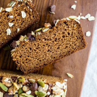 Healthy Sweet Potato Bread made with almond and oat flours, sweetened with maple syrup and sweet potato puree, warming spices, and topped with seeds, nuts, and chocolate chips. Gluten-free, dairy-free.
