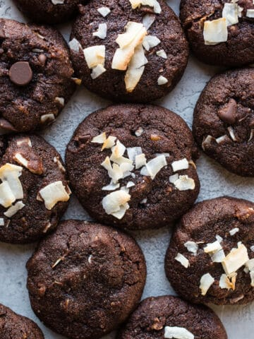 Double Chocolate Coconut Pecan Cookies are rich, chocolatey, and loaded with flaked coconut, pecans, and chocolate chips. Gluten-free, paleo, dairy-free.