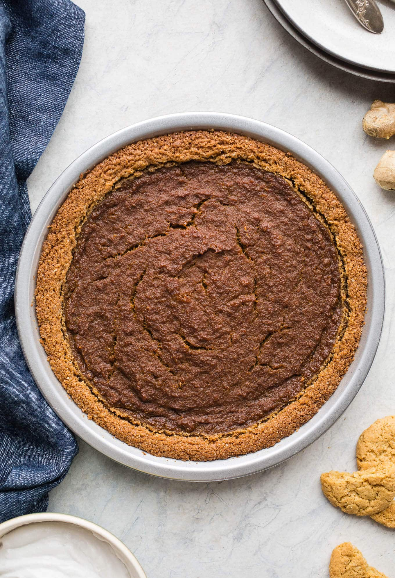 Gingersnap Pumpkin Pie makes for a delicious take on a classic dessert. Made with gingersnap cookie crust and sweetened with coconut sugar and maple syrup. Gluten-free and vegan friendly.