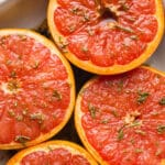 Grapefruit halves topped with maple syrup, cinnamon, rosemary, and a pinch of sea salt make for a delicious sweet and salty breakfast or brunch option. Gluten-free, vegan.
