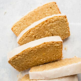 Gluten-Free Iced Lemon Cake made from almond flour, white rice flour, and cornstarch, fresh lemon juice and lemon zest, and coated in a lemon icing glaze. Sweet, tart, and delicious. Gluten-free, dairy-free.