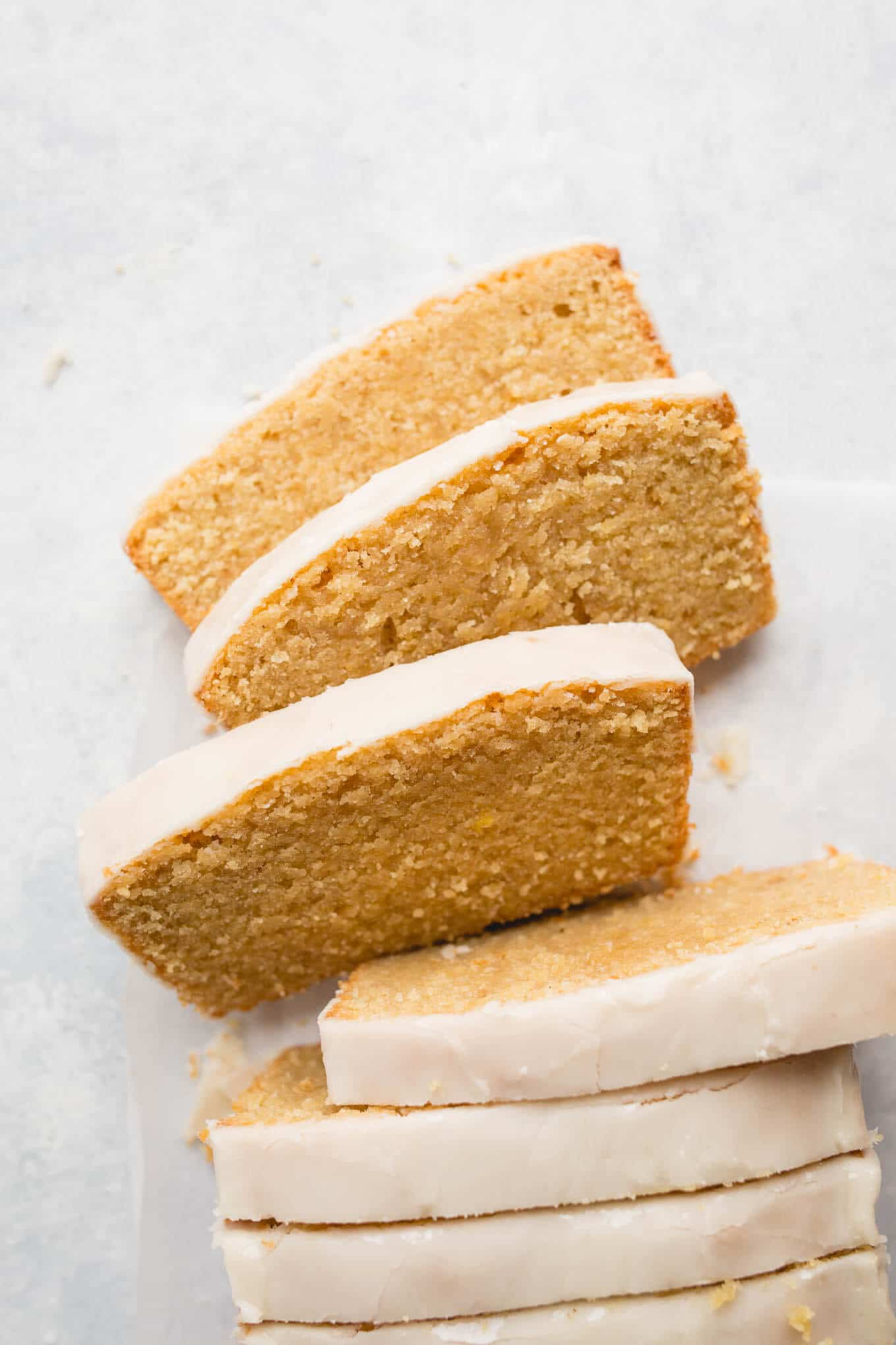 Gluten-Free Iced Lemon Pound Cake made from almond flour, white rice flour, and cornstarch, fresh lemon juice and lemon zest, and coated in a lemon icing glaze. Sweet, tart, and delicious. Gluten-free, dairy-free.
