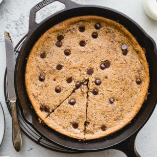 Salted Tahini Chocolate Chip Cookie Skillet is a an easy one-bowl recipe made with almond four, tahini, maple syrup, and studded with chocolate chips. Gluten-free, vegan, refined sugar-free.