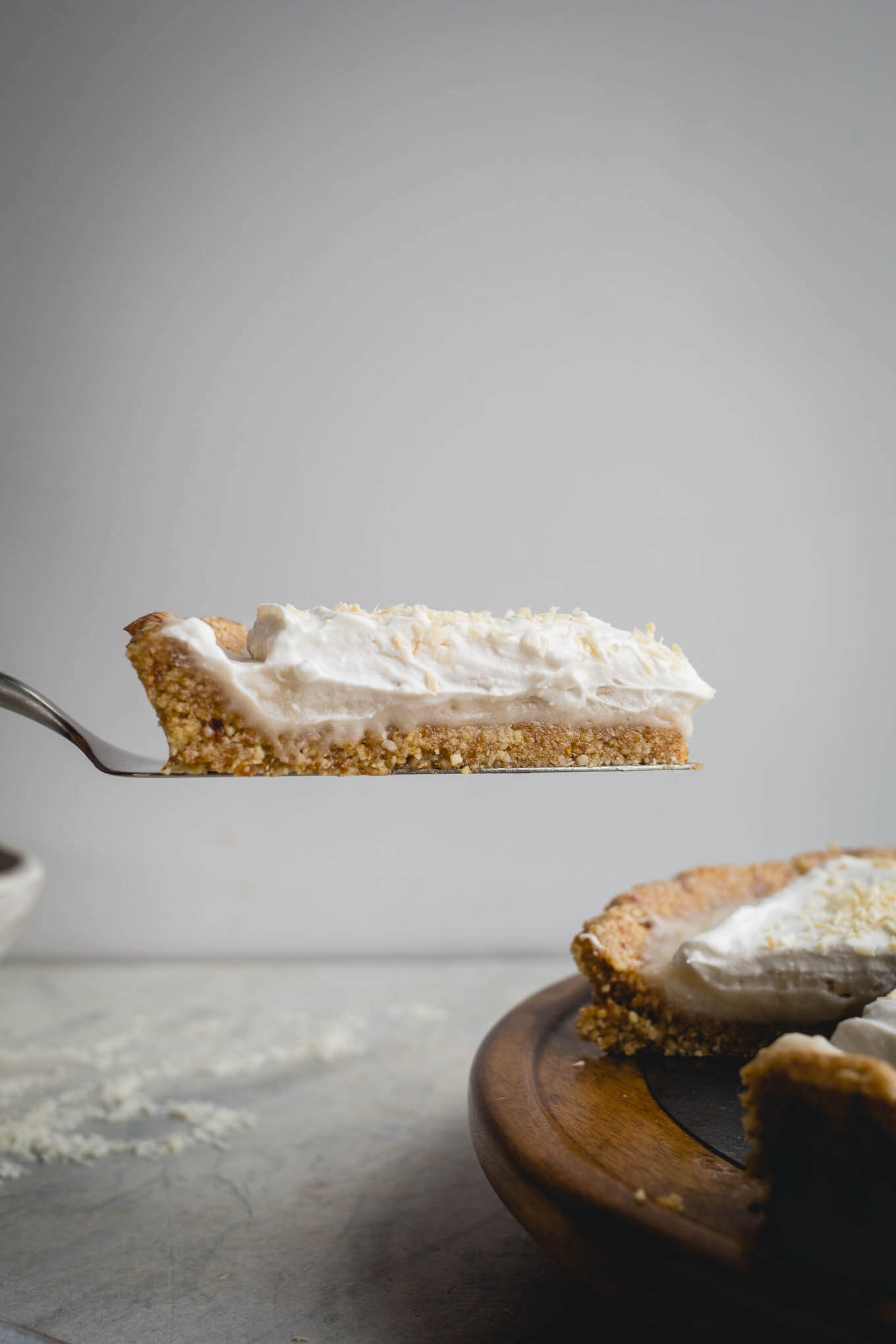 This No-Bake Coconut Cream Pie is made with a sprouted almond press-in crust, coconut milk pudding filling, and topped coconut cream and toasted shredded coconut. Gluten-free, vegan.