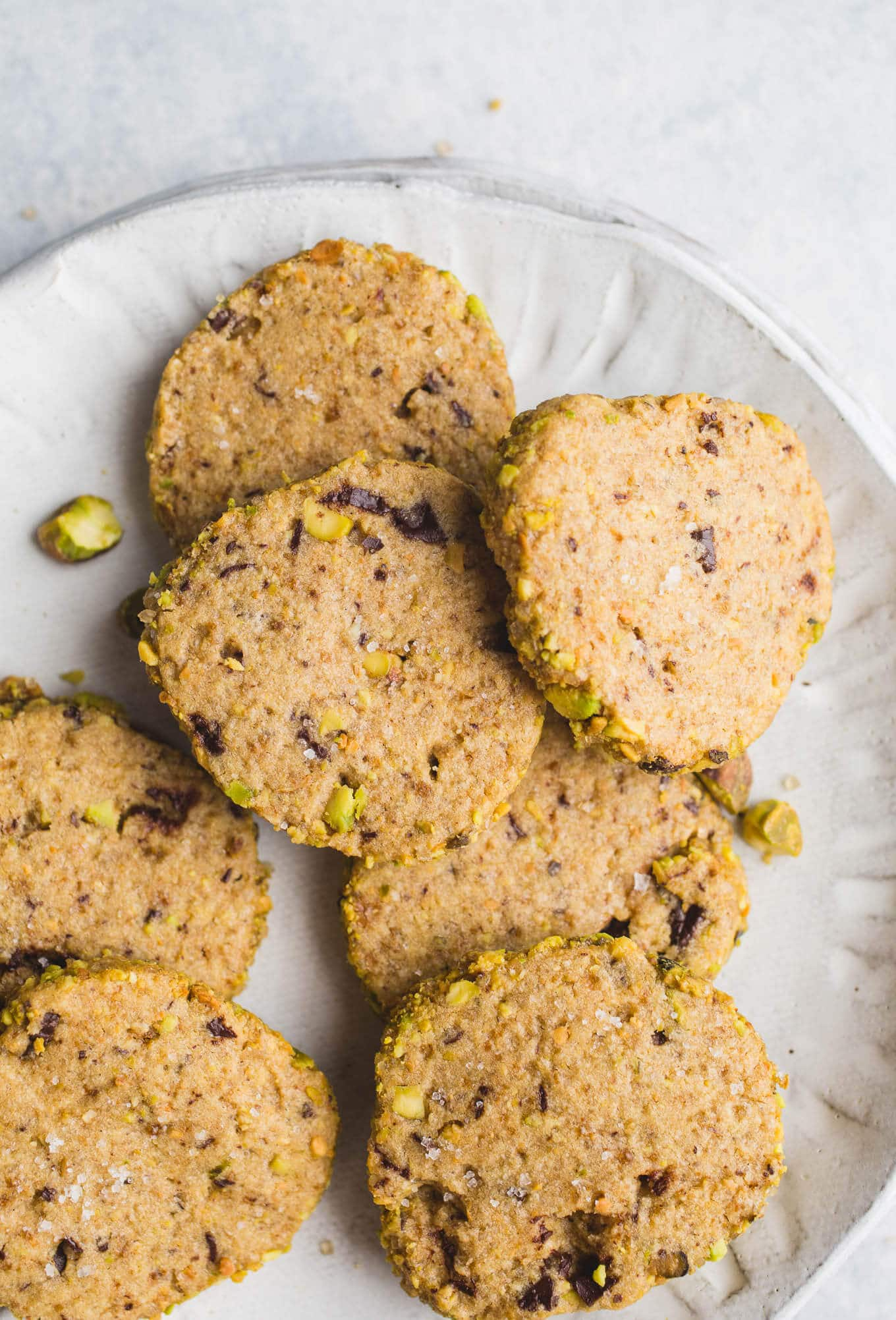 Gluten-Free Pistachio Shortbread Cookies are made with gluten-free flours, raw pistachios, and chopped chocolate for a sweet, buttery treat.