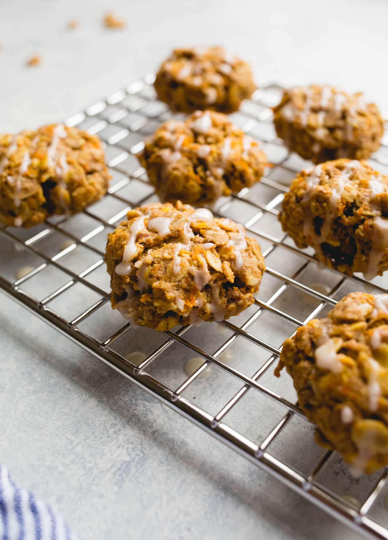 Gluten-Free Carrot Oatmeal Cookies are full of wholesome oats, carrots, flaxseeds, and walnuts for a deliciously healthy treat. Vegan, refined sugar-free.