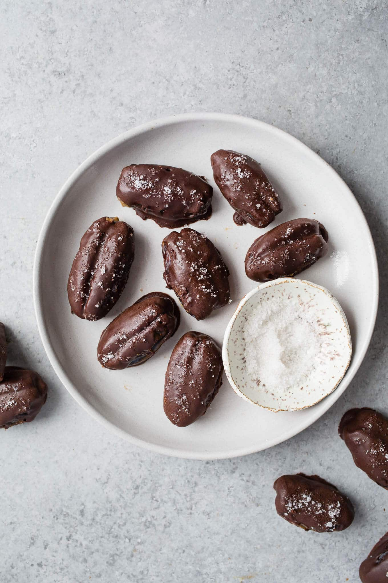 These Chocolate-Covered Almond Butter Stuffed Dates topped with sea salt are gluten-free, vegan, and refined sugar-free. Perfect for a snack or dessert!