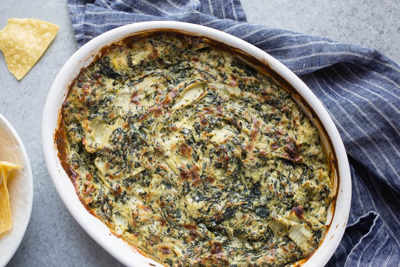 Baked Vegan Spinach Artichoke Dip is made dairy-free with a cashew cream base. An easy appetizer dip recipe for a crowd.