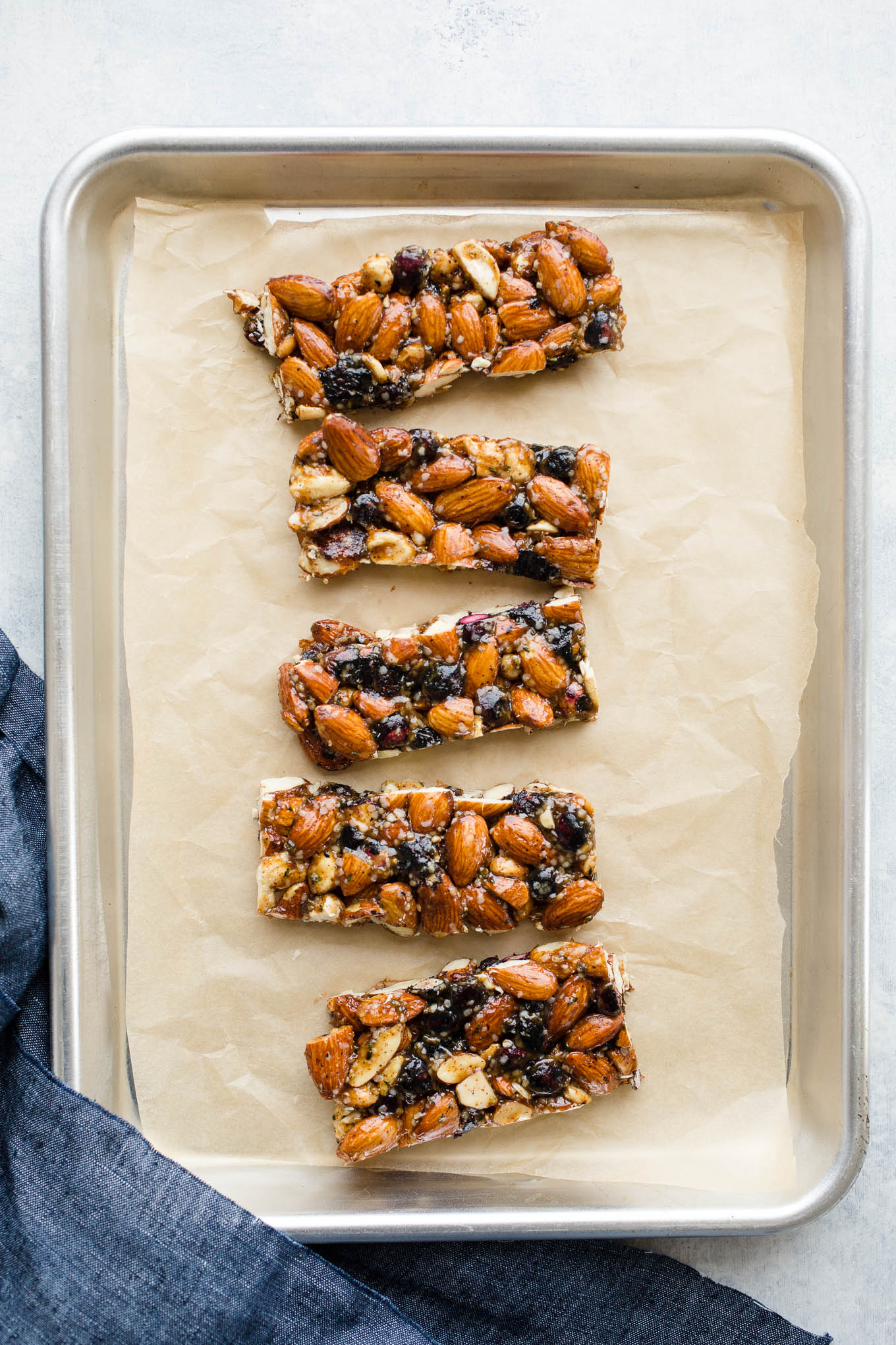Blueberry Almond Granola Bars made with raw almonds, cashews, and hemp seeds, and bursting with dried blueberries. A healthy granola bars recipe made without refined sugar. Gluten-free, vegan.