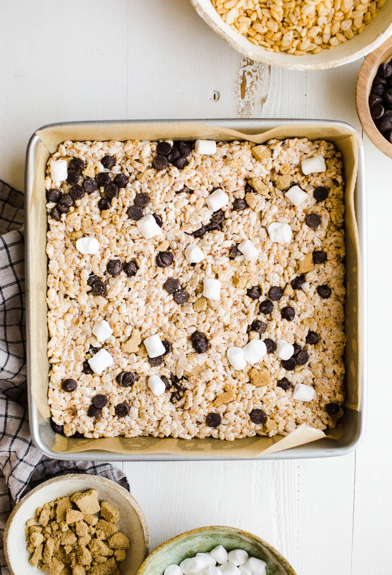 This S'mores Rice Krispies Treats recipe made with rice cereal, graham crackers, chocolate chips, and mini marshmallows makes for a fun variation!
