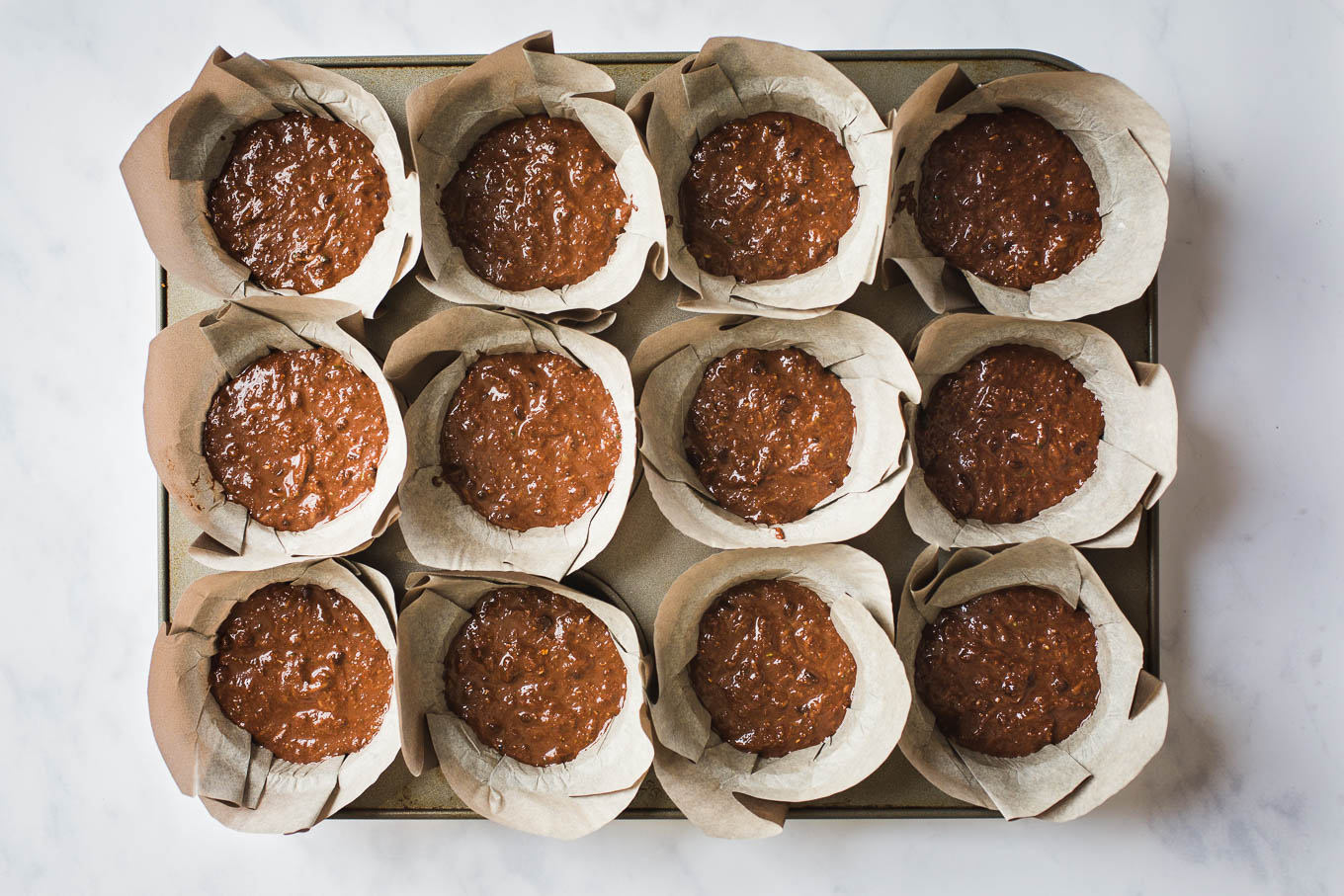 Vegan Gluten-Free Chocolate Zucchini Muffins made with almond flour, unsweetened cocoa powder, fresh zucchini, and sweetened with coconut sugar.