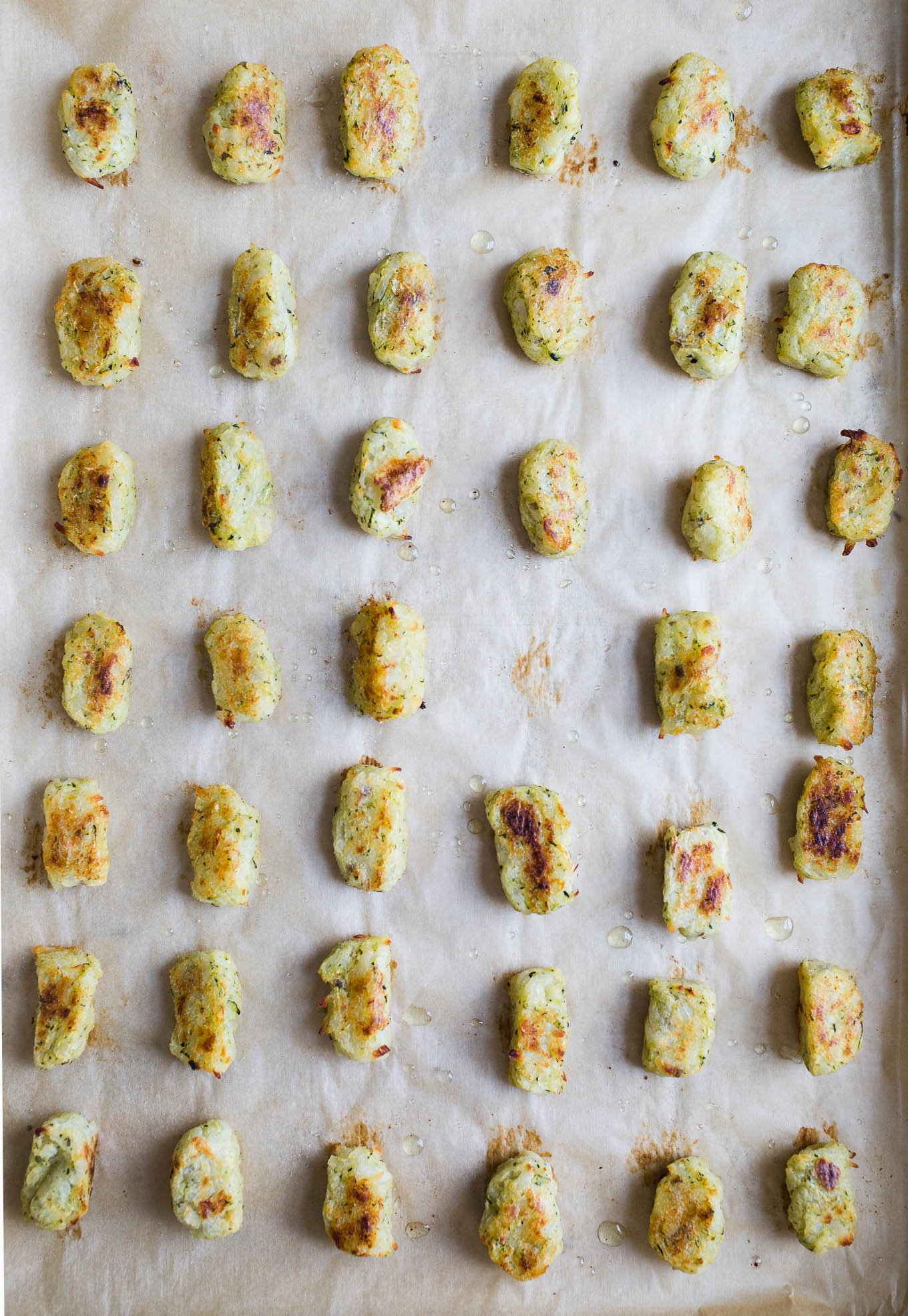 Baked Zucchini Tater Tots make for a veggie-friendly side dish, appetizer, or snack. Made with fresh zucchini and russet potatoes, these 4-ingredient zucchini tots are sure to be a crowd-pleaser. Gluten-free, vegan.