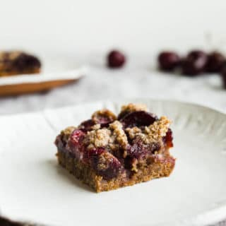 Gluten-Free Cherry Crumble Bars that use fresh cherries, wholesome almond flour, and unrefined coconut sugar. Part cherry pie, part coffee cake, all good! Vegan too.