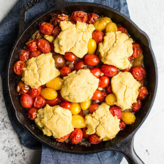 Gluten-Free Tomato Cobbler with Corn Flour Biscuits makes for savory side dish or a vegetarian main course. An easy tomato cobbler recipe that is vegan too!