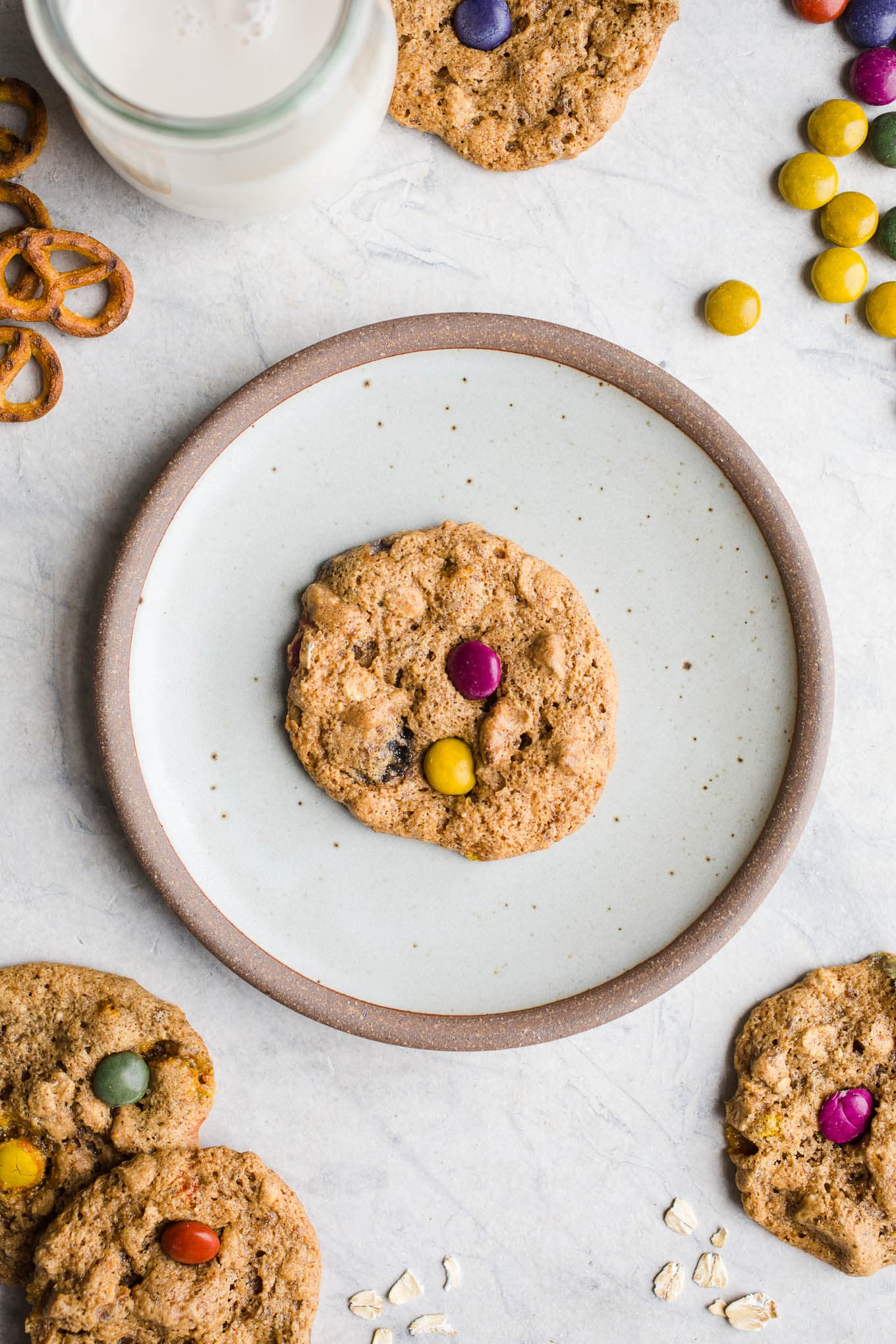 Almond Butter Monster Cookies made with gluten-free oats, pretzels, and chocolate pieces for a protein-packed gluten-free cookie. Vegan.