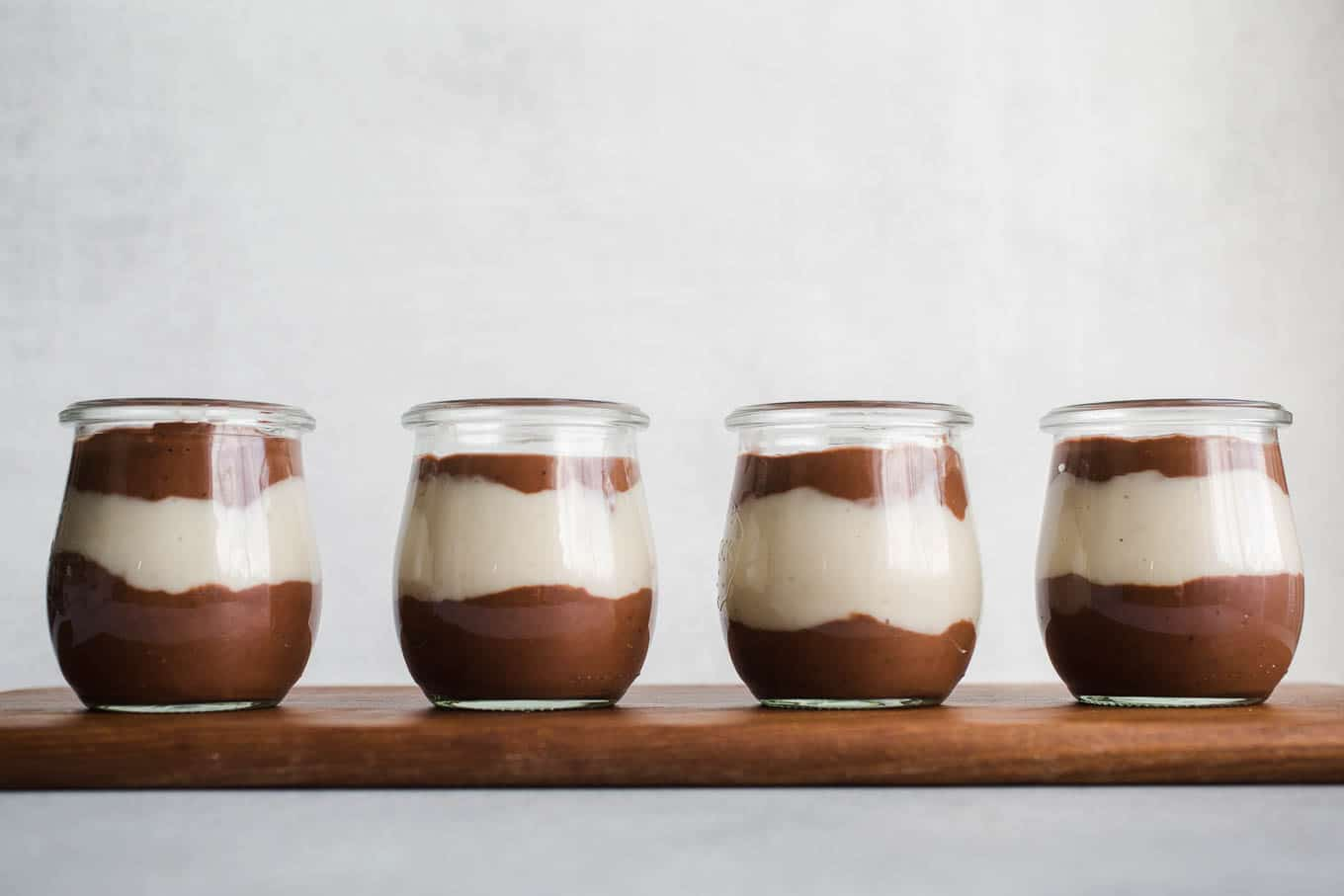 Vegan Chocolate Vanilla Pudding Cups made with rich chocolate cocoa powder, coconut milk, almond milk, maple syrup, and pure vanilla extract. An easy gluten-free, dairy-free pudding recipe!