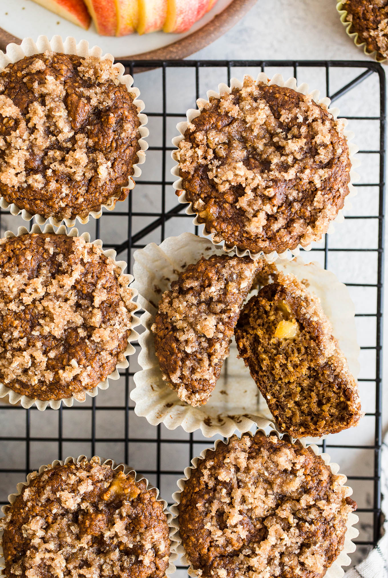 Gluten-Free Apple Crumb Muffins are made with whole grain gluten-free oat flour, almond flour, applesauce, and coconut sugar topped with a cinnamon sugar crumble. Dairy-free, vegan.