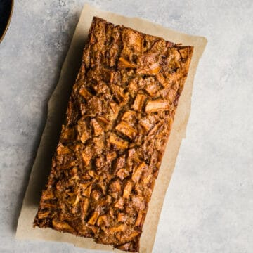 Gluten-Free Apple Pound Cake topped with caramelized apples and spices. Dairy-free.