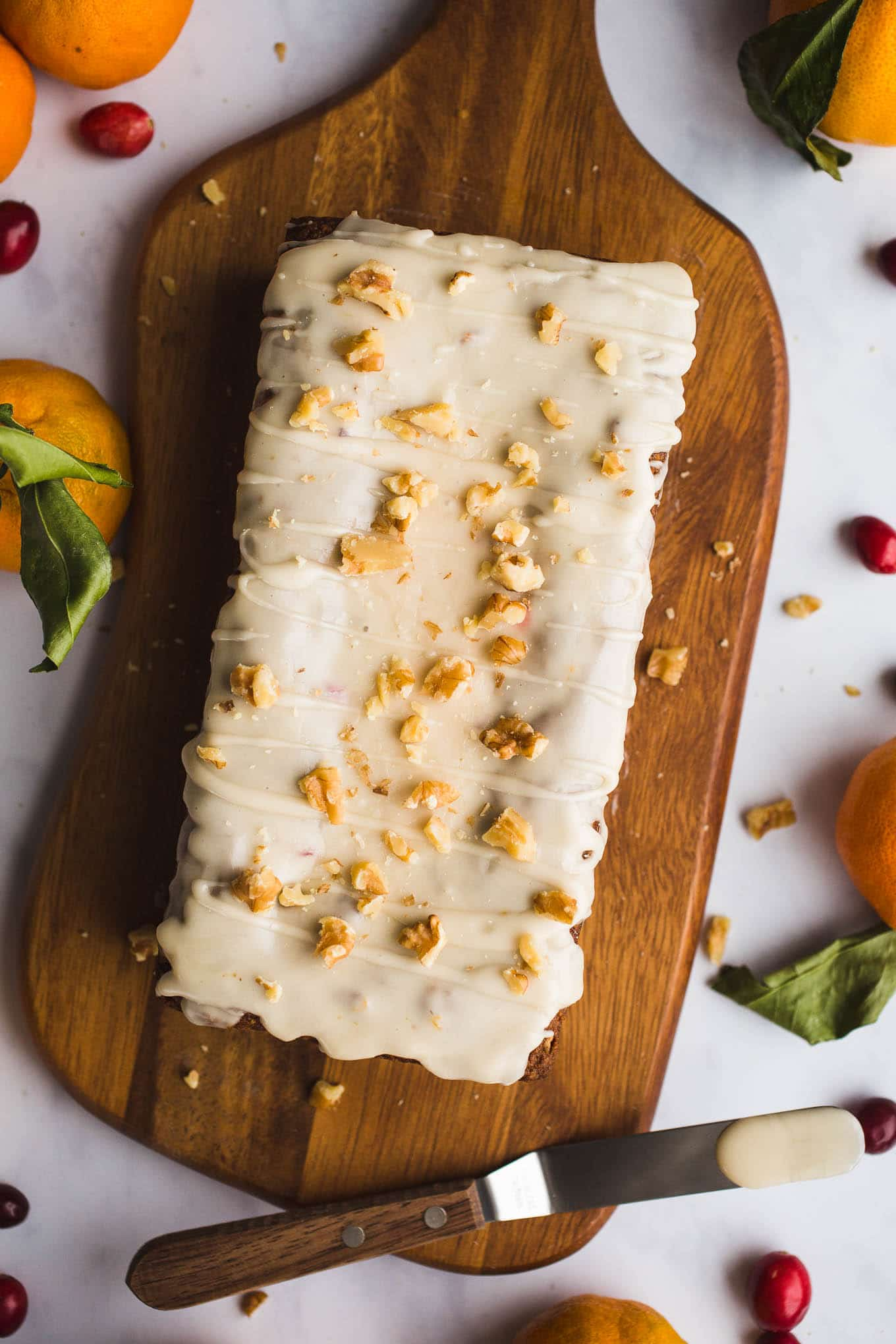A healthier, moist, Gluten-Free Cranberry Orange Bread with an orange glaze made with almond and oat flours. Vegan. Have it for breakfast or dessert!