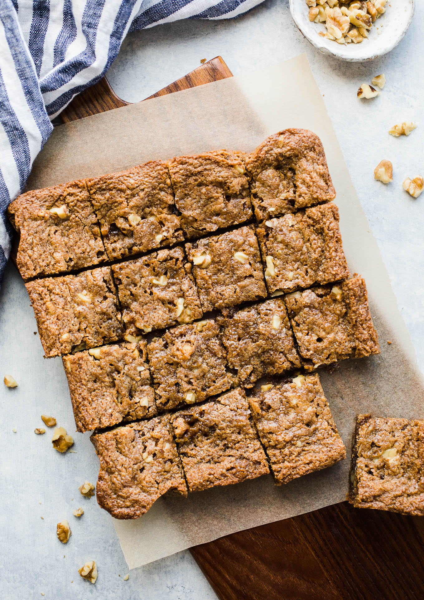 Gluten-Free Maple Walnut Blondies made with almond flour, sweet rice flour, almond butter, walnuts, and infused with maple syrup. A delicious flavor combination that makes for a chewy vegan blondie recipe.