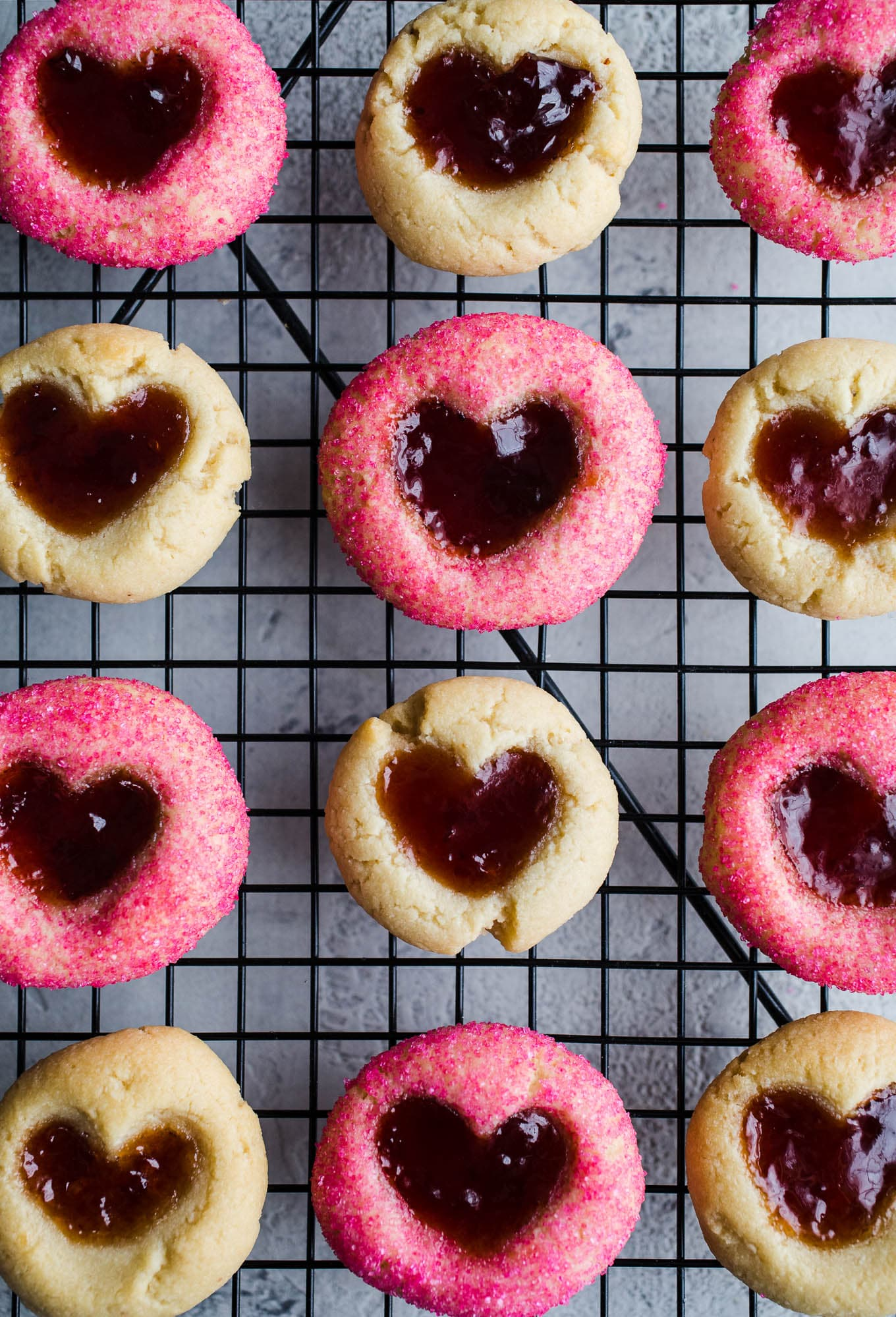 Easy 5-ingredient thumbprint cookies made with almond flour and sweetened with maple syrup, filled with your favorite jam. A gluten-free, vegan thumbprint cookie recipe!