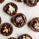 Vegan Gluten-Free Brownie Bites recipe made in a mini muffin pan for individual portions. Made flourless with a combination of almond butter and cocoa powder and topped with an easy dairy-free chocolate ganache.