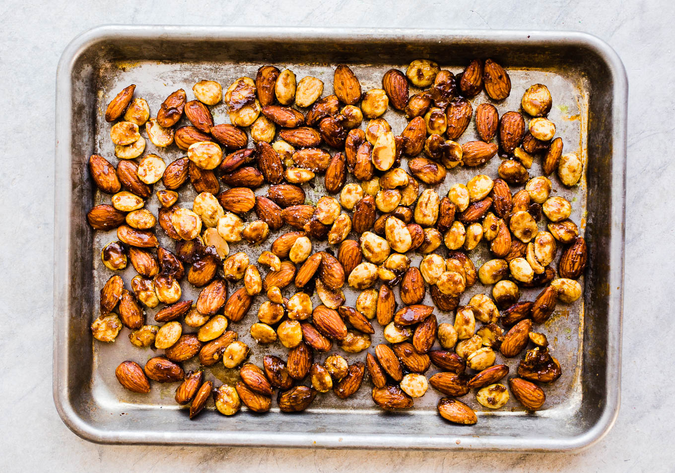 spiced almonds on baking sheet