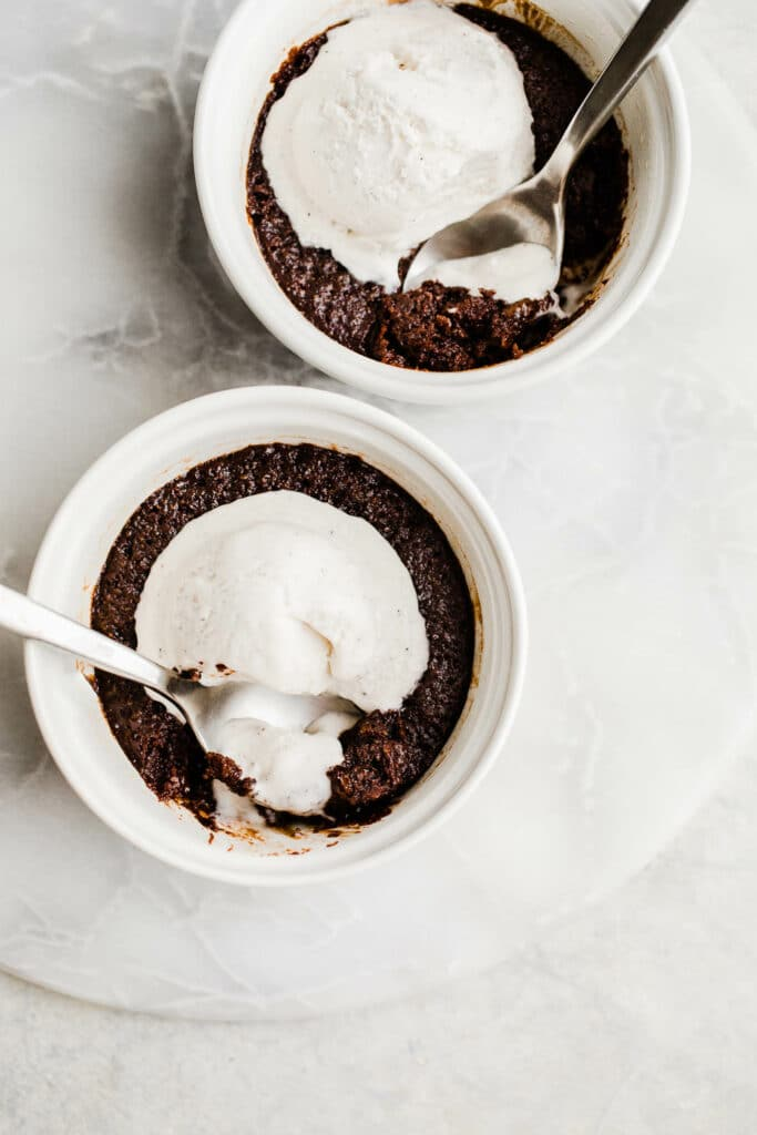 chocolate cakes with ice cream in white ramekins