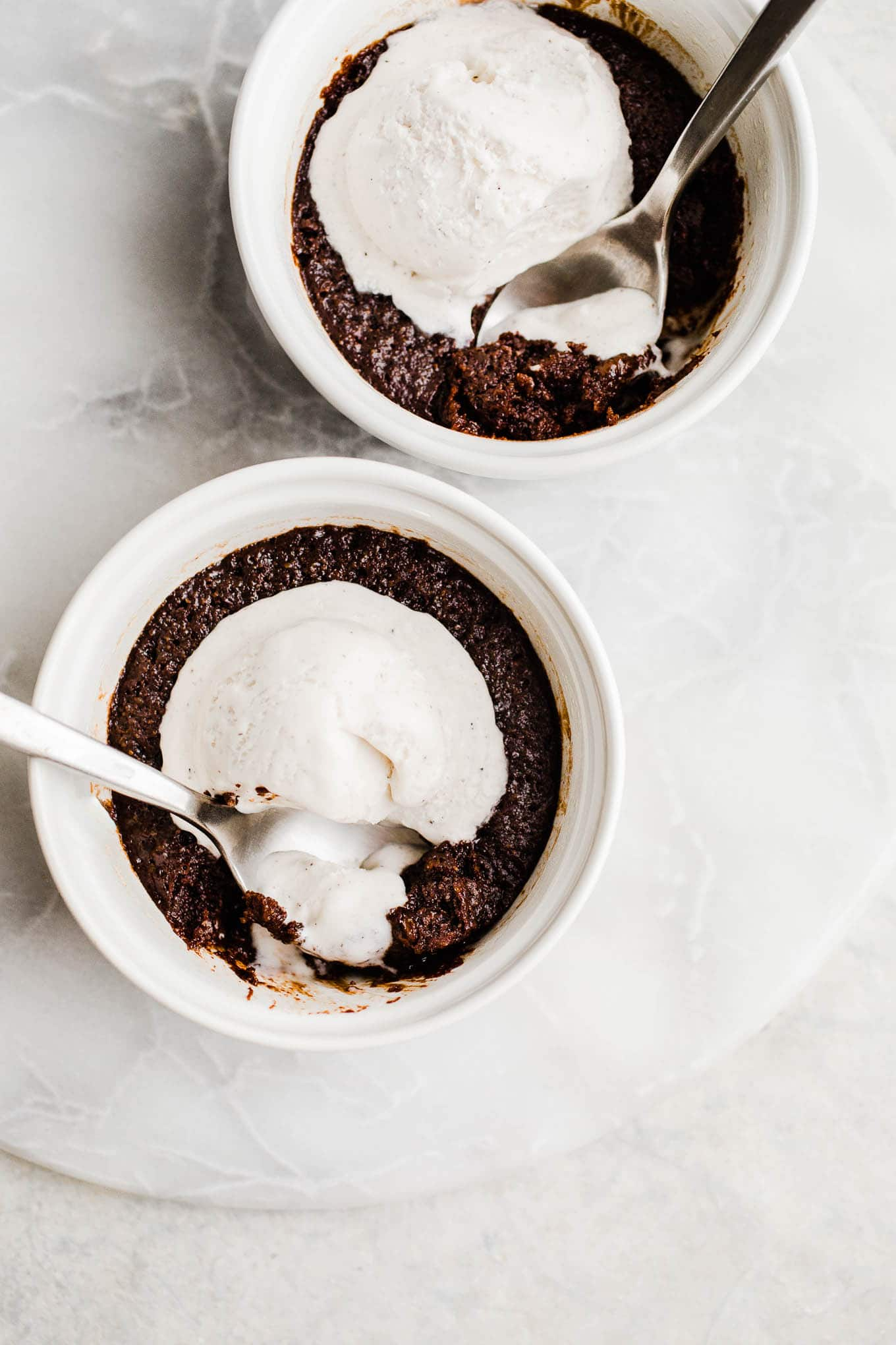 chocolate cakes with melting ice cream in ramekins