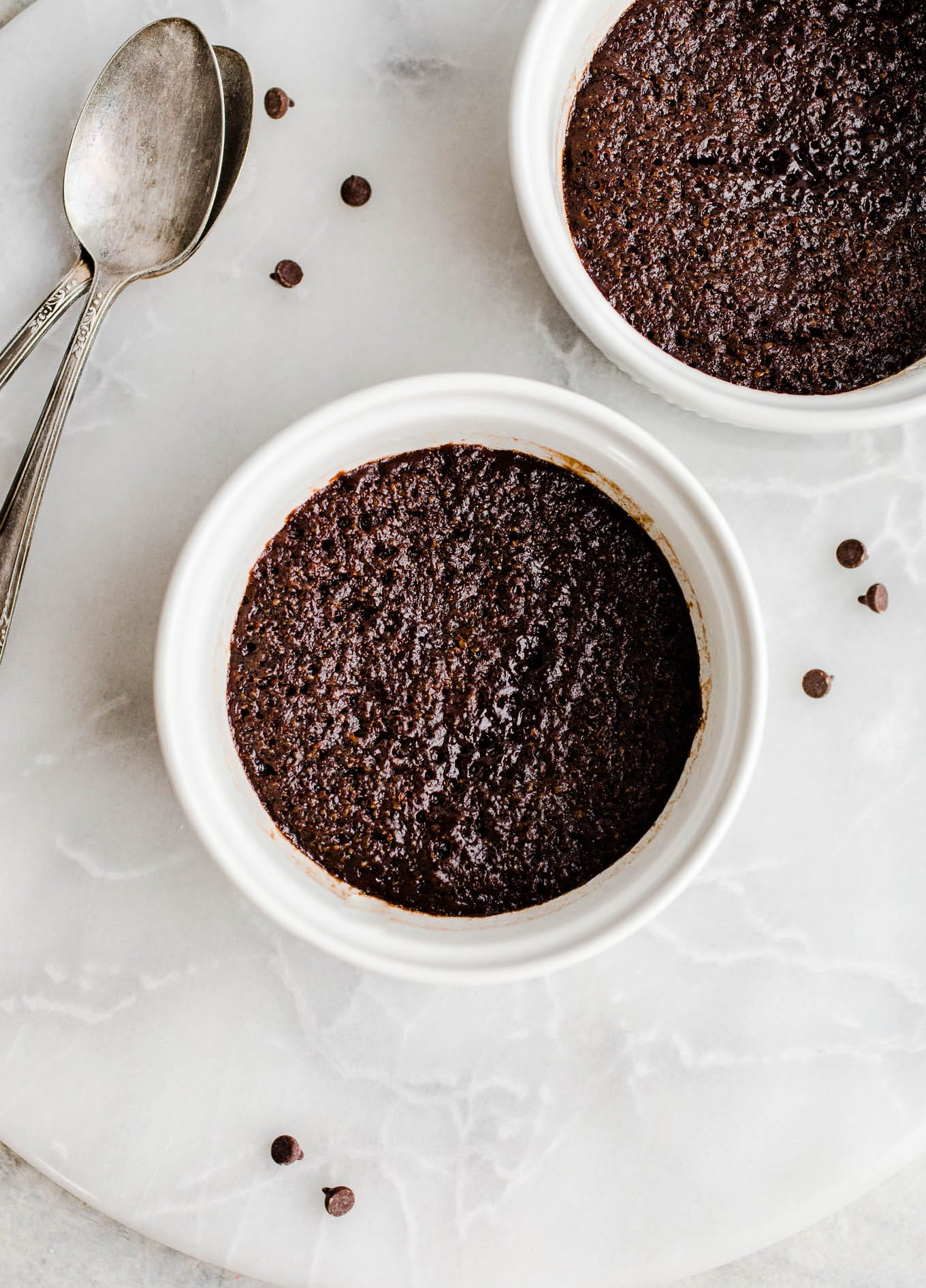 almond flour chocolate mug cakes in white ramekins