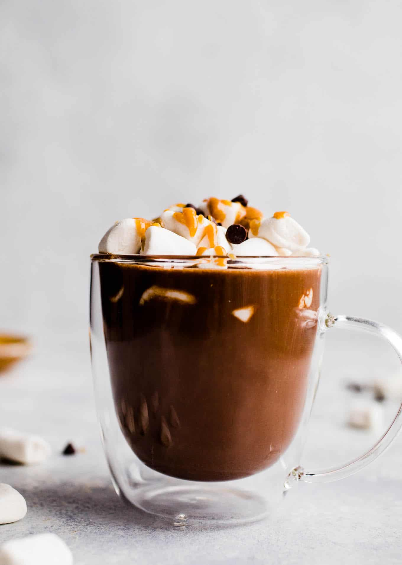 peanut butter hot chocolate in a glass mug