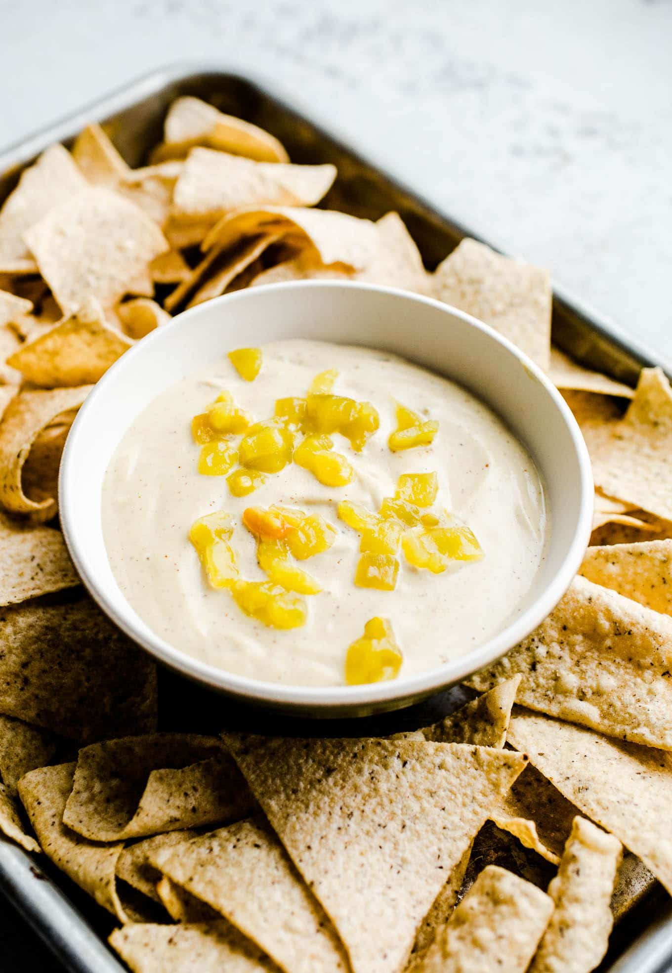 Vegan queso blanco with hatch chilis and chips
