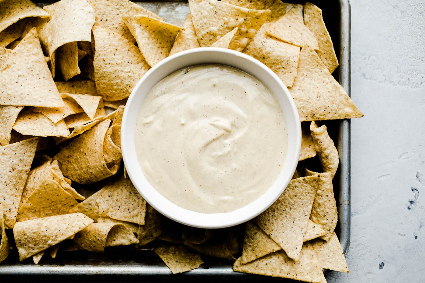 queso blanco in bowl with chips