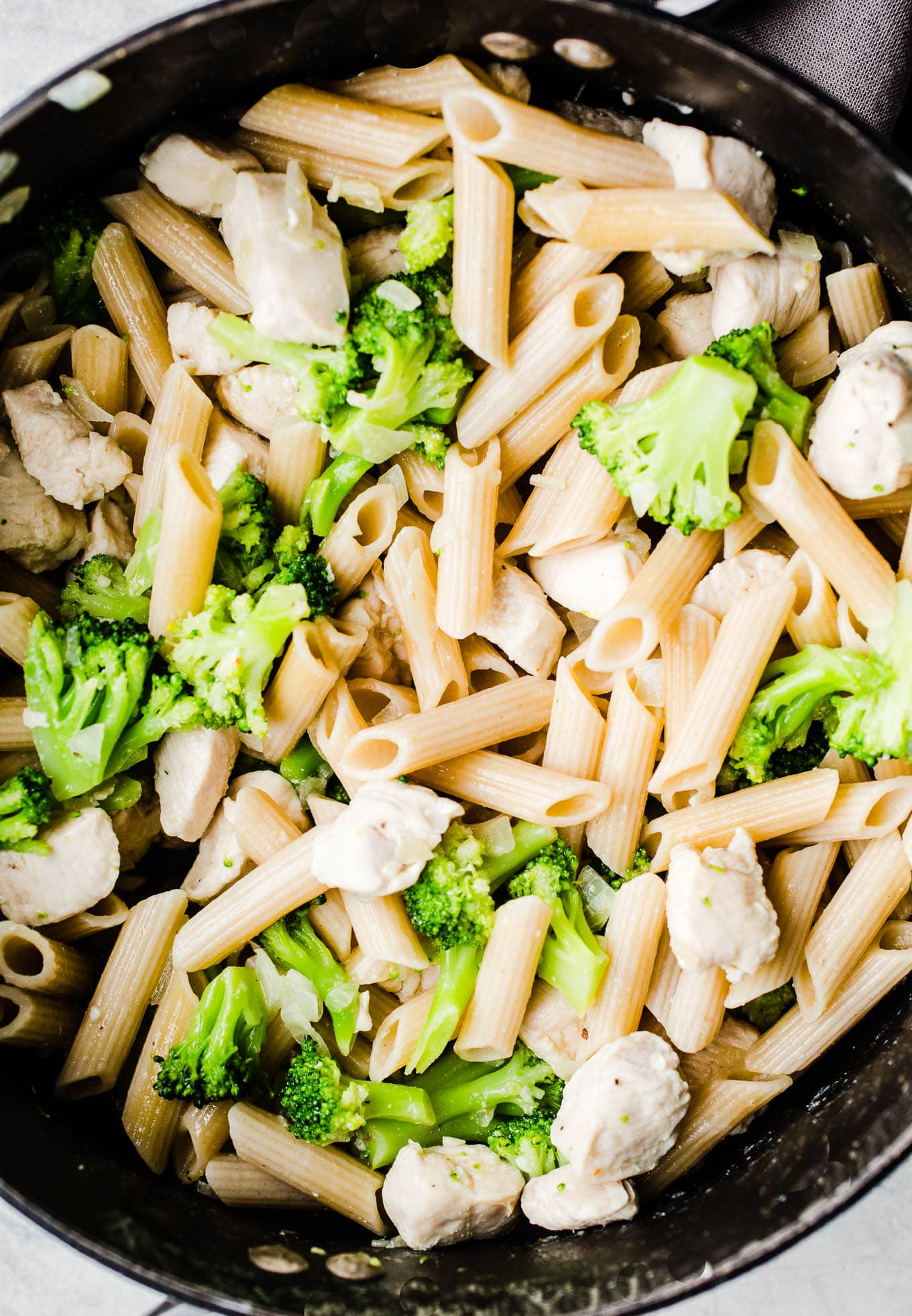 chicken and broccoli with pasta in pot