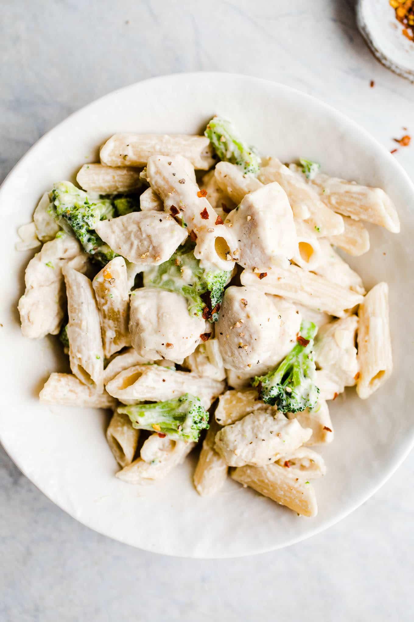 chicken broccoli pasta in a white bowl
