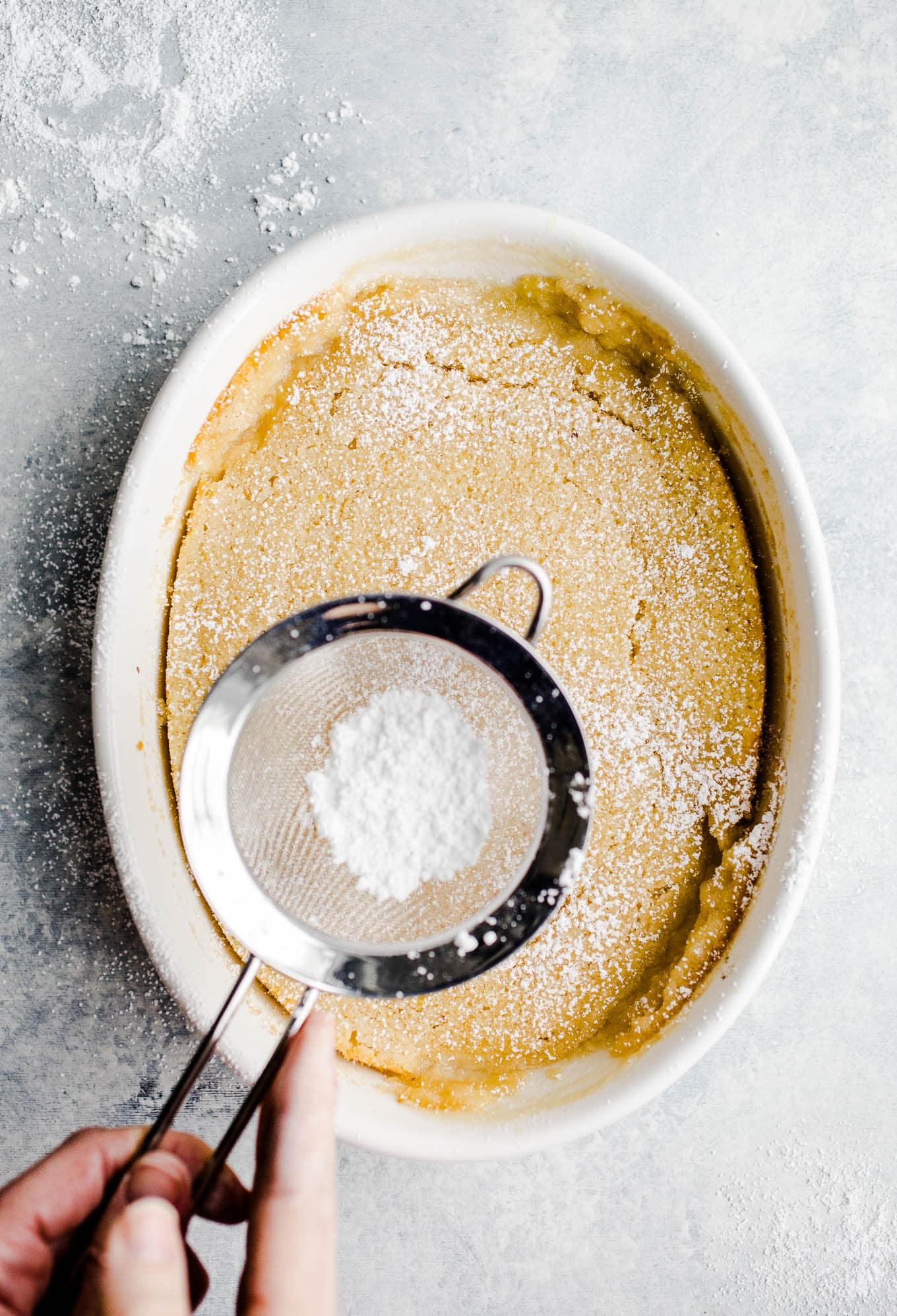 lemon pudding cake sprinkled with powdered sugar
