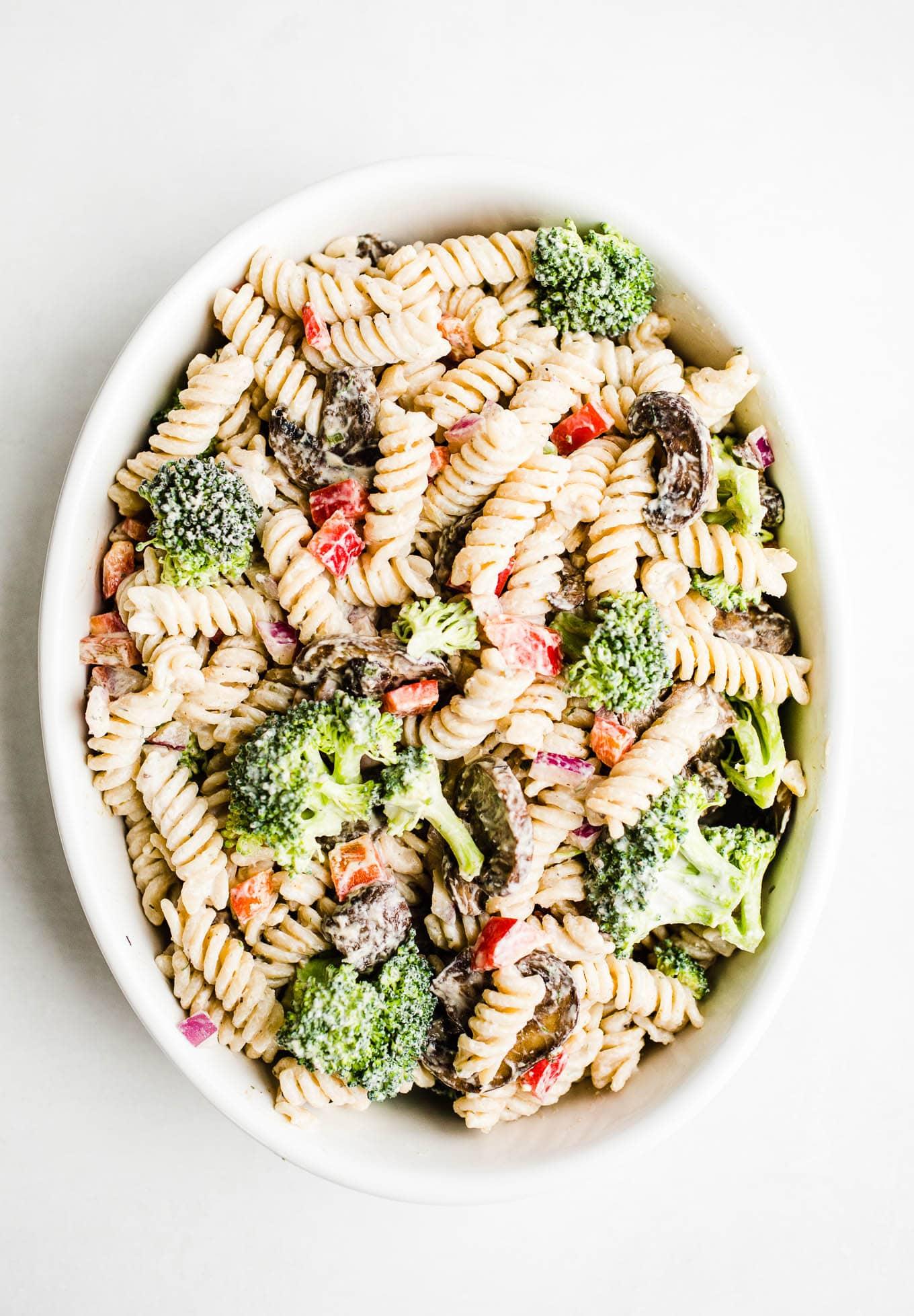 creamy pasta salad in white bowl