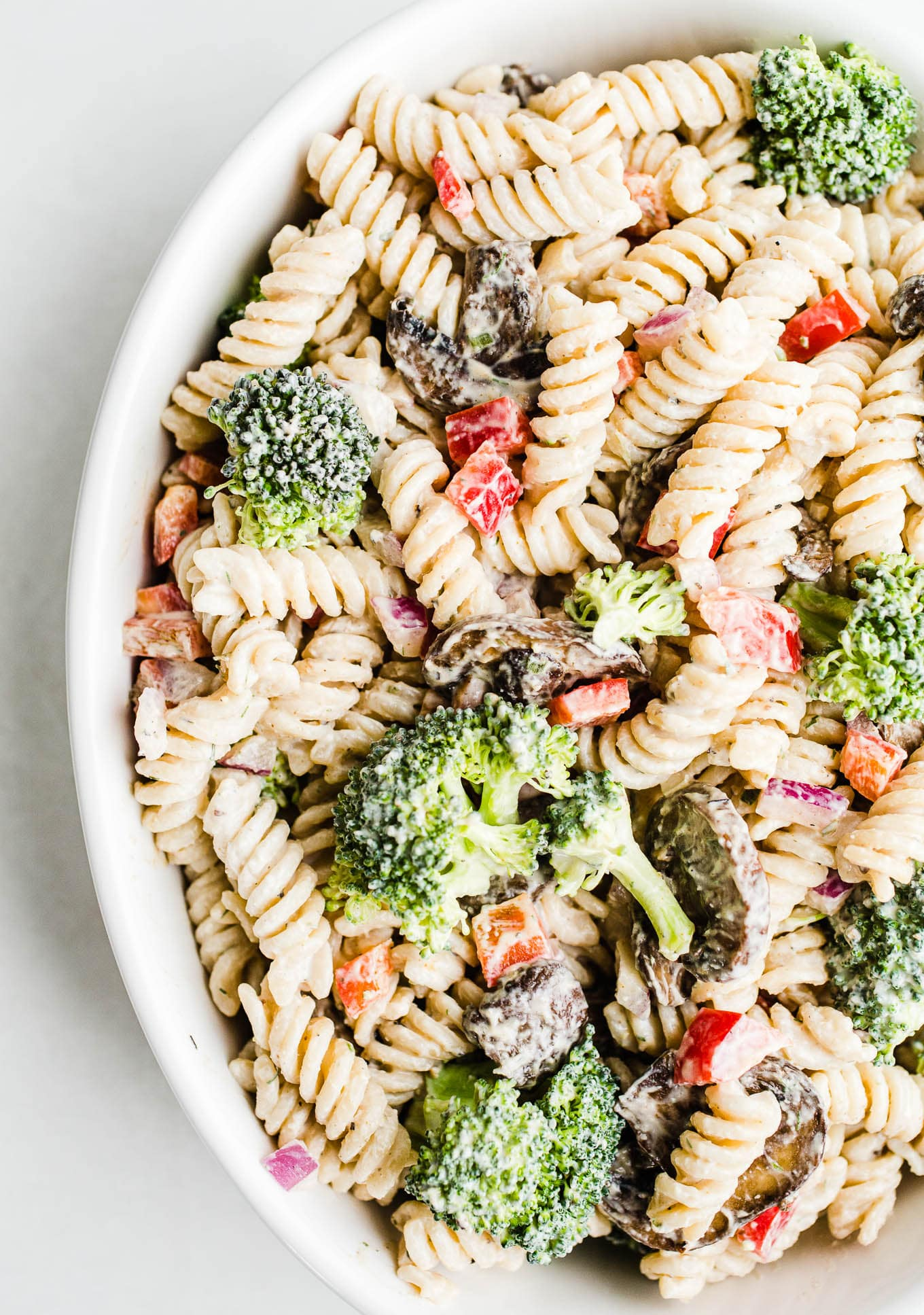pasta with vegetables in white bowl