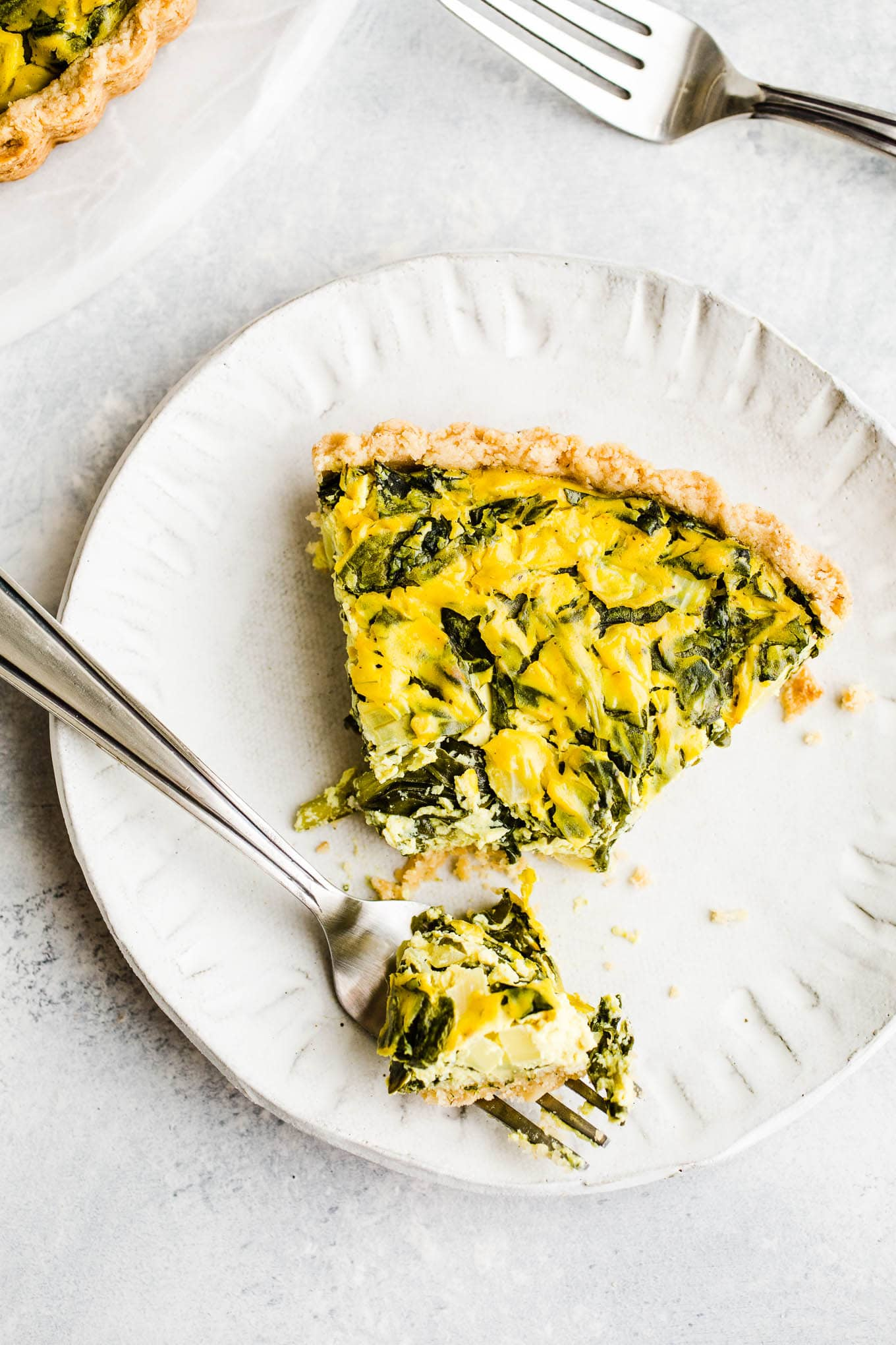 vegetarian quiche on plate with fork