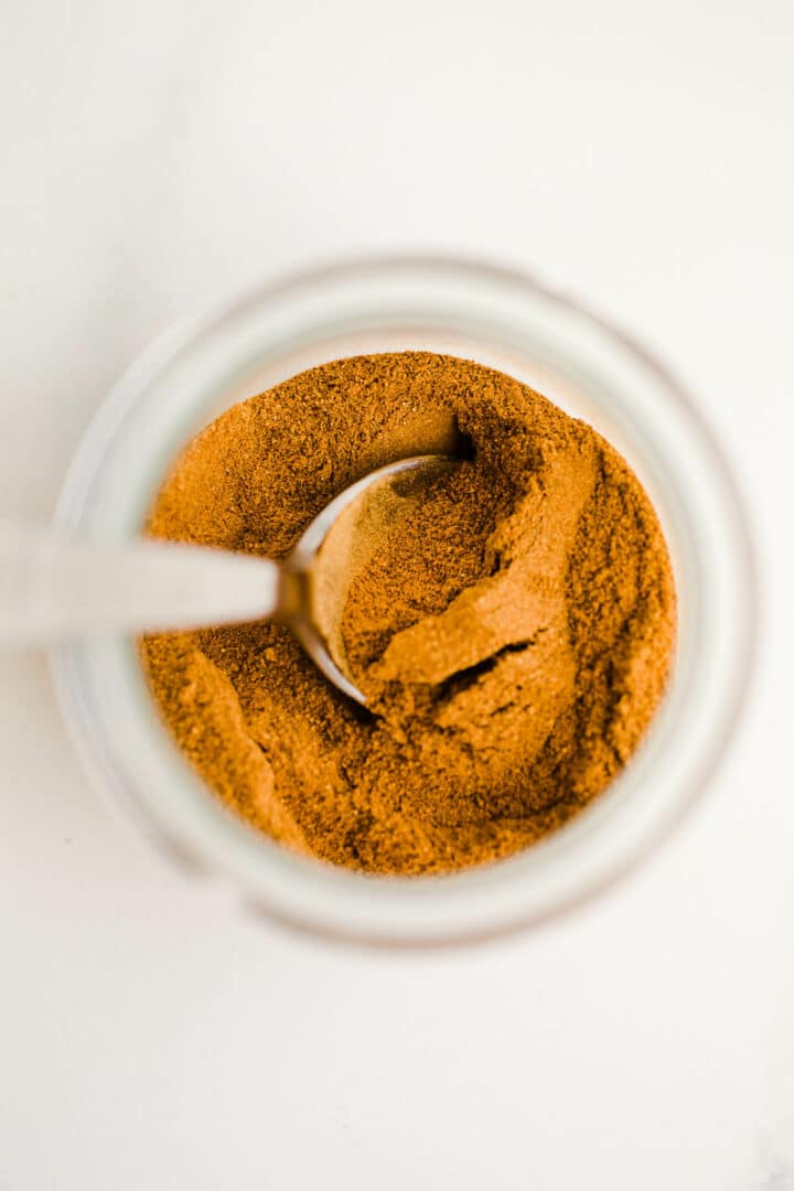 spices in jar with spoon